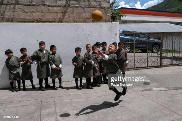 At the Thimphu Primary private school students play ball during recess on June 13, in Thimphu, Bhutan. Bhutan is no ordinary place, it is known an...