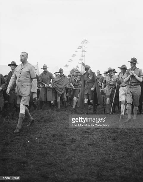 At the third World Scout Jamboree Robert BadenPowell founder of the Scout movement and writer of Scouting for Boys walking with the Prince of Wales...