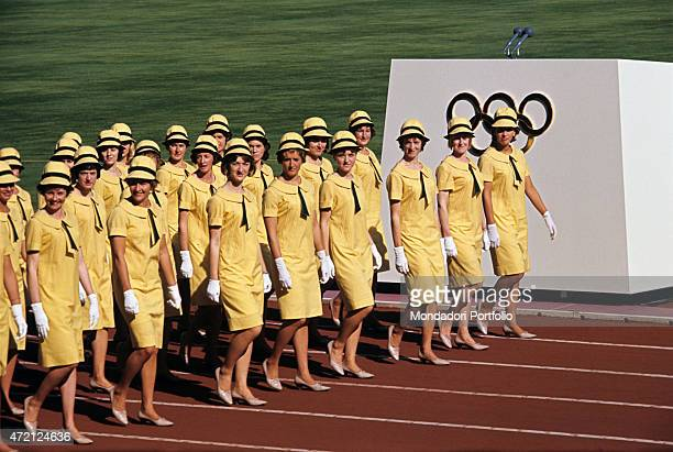 'At the Tokyo National Stadium the Australian athletes parade during the opening ceremony of the XVIII Olympic Games wearing an attractive and...