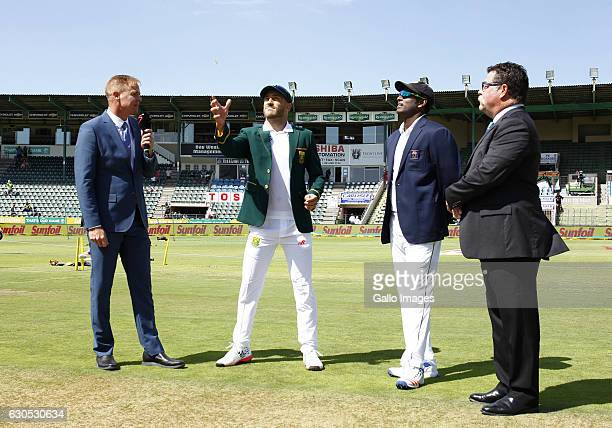 At the toss Faf Du Plessis flips the coin during day 1 of the 1st Test match between South Africa and Sri Lanka at St George's Park on December 26...