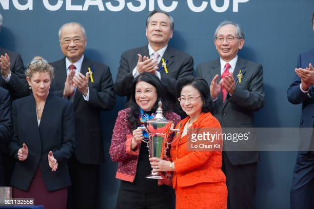 KONG FEBRUARY At the trophy presentation ceremony HKJC Steward Margaret Leung presents the Hong Kong Classic Cup trophy to Singapore Sling's owner...