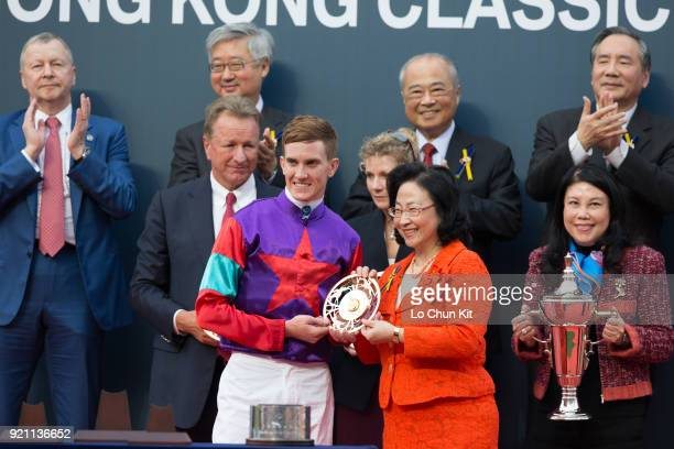 KONG FEBRUARY At the trophy presentation ceremony HKJC Steward Margaret Leung presents the Hong Kong Classic Cup goldplated dishes to Singapore...