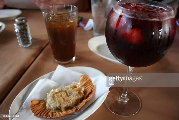 At the Tropical Breeze Restaurant in Flowery Branch near Lake Lanier the Cuban fare like this empanada and homemade sangria is so authentic that it's...