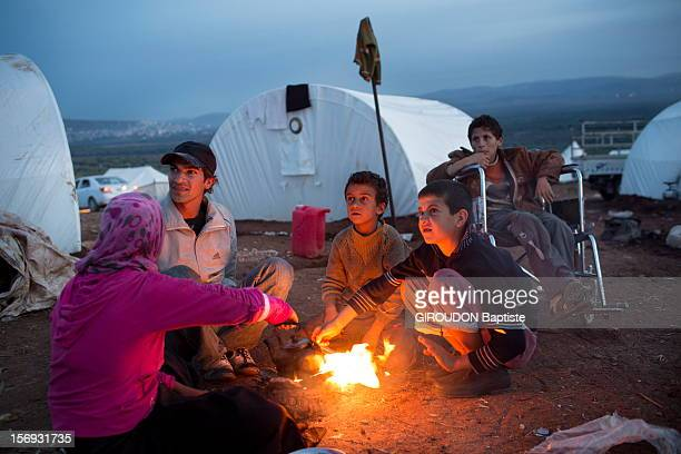 At the Turkish border tens of thousands of Syrian refugees fleeing the massacres perpetrated by the Assad army came to live in the camp and wait...