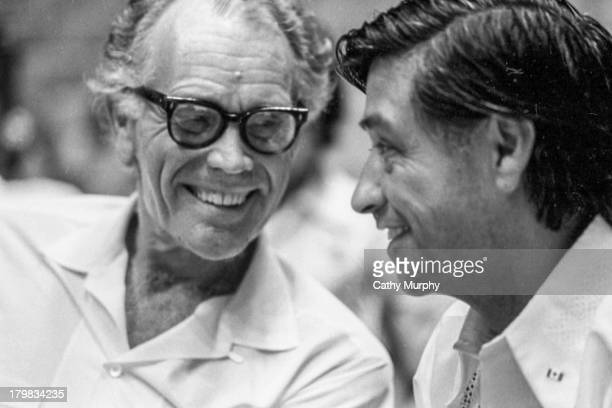 At the United Farm Workers convention labor activist and United Farm Workers cofounder Cesar Chavez shares a laugh with Fred Ross Sr La Paz...