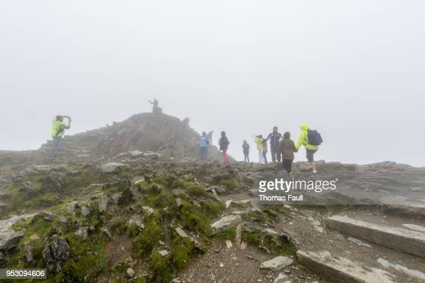 at the very summit of mount snowdon in wales - mount snowdon stock photos and pictures