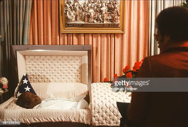 At the wake for Jazz musician Professor Longhair fellow musician Allen Toussaint looks in the open casket New Orleans Louisiana February 1980