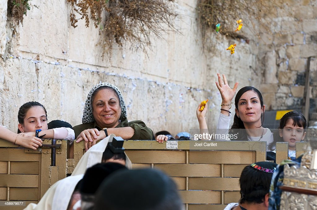 Throwing candy at bar mitzvah by Western Wall : Stock Photo