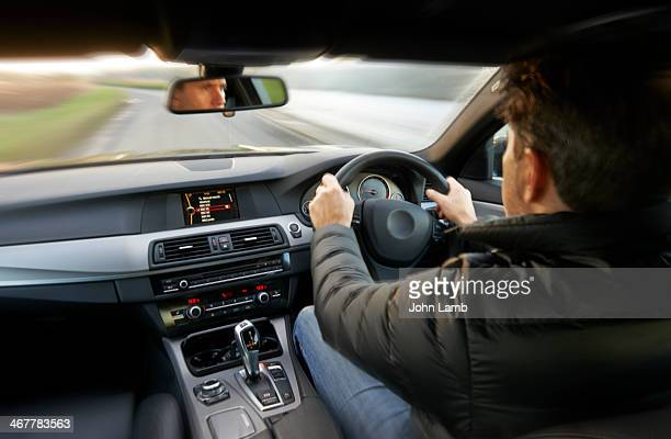 at the wheel - driving stock pictures, royalty-free photos & images