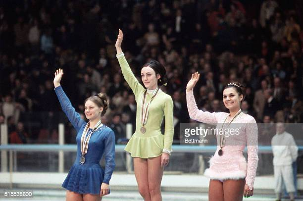 At the Winter Olympics in Grenoble France US Gold medalist Peggy Fleming Gabrielle Seyfert and Hana Makova in center ice after medal ceremony for...