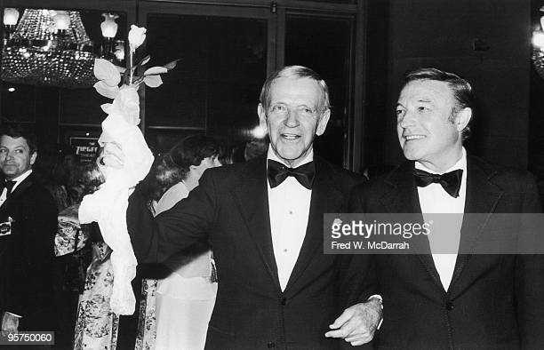 At the Ziegfeld Thearte American actors and dancers Fred Astaire and Gene Kelly attend the premiere of the film 'That's Entertainment Part II' which...