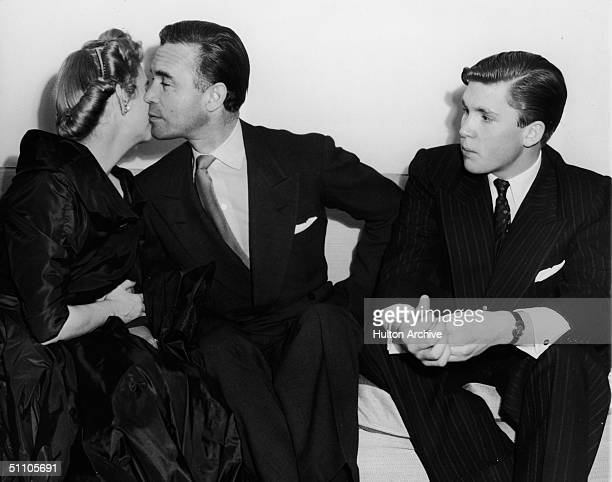 At their wedding reception American socialite and Woolworth's heiress Barbara Hutton and Dominican diplomat and socialite Porfirio Rubirosa kiss each...