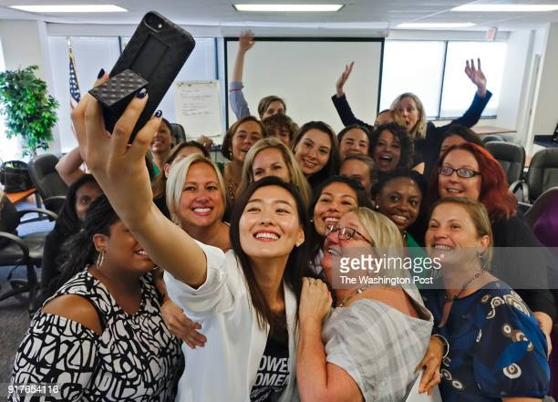 At this the final training session in a sixmonth series for a cohort of 24 women seen Saturday July 22 Johanna Shin holds her cameraphone as she...