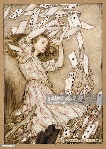 At this the whole pack rose up into the air and came flying down upon her from Alice's Adventures in Wonderland by Lewis Carroll pub 1907 colour...