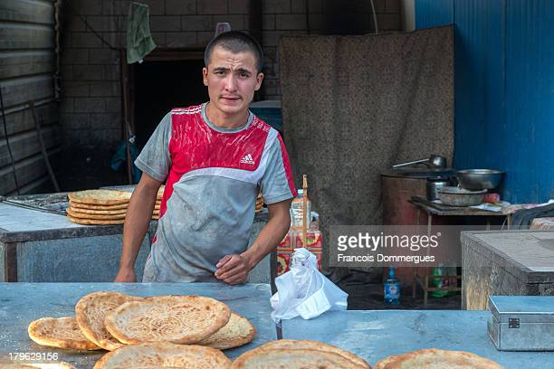 At Turpan Bazaar, bread is baked on the spot and sold fresh to customers.
