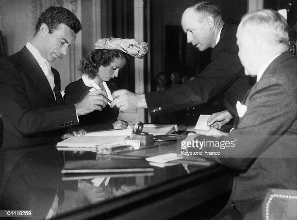 At Vichy town hall the young actress Danielle DARRIEUX is signing the marriage register with the Dominican ambassador in Argentina Porfirio RUBIROSA...