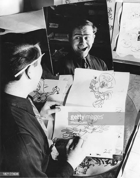 At Walt Disney Studios an unidentified animator makes faces in a mirror which he uses as raw material for his character's expressions California 1946
