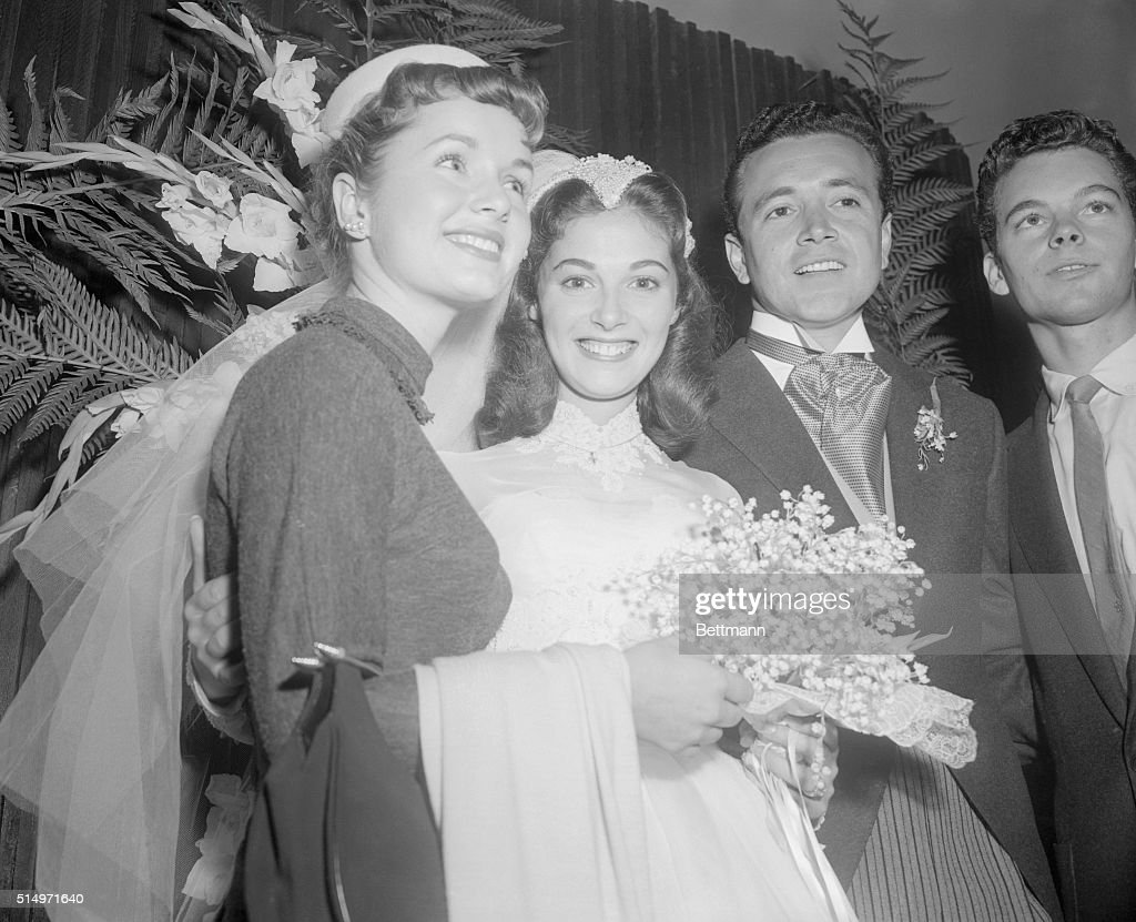 At wedding reception...Bride-to-be Debbie Reynolds, who is engaged to singer Eddie Fisher, congratulates bride Pier Angeli and groom Vic Damone at the couple's wedding reception November 24th at the Bel Air Hotel.