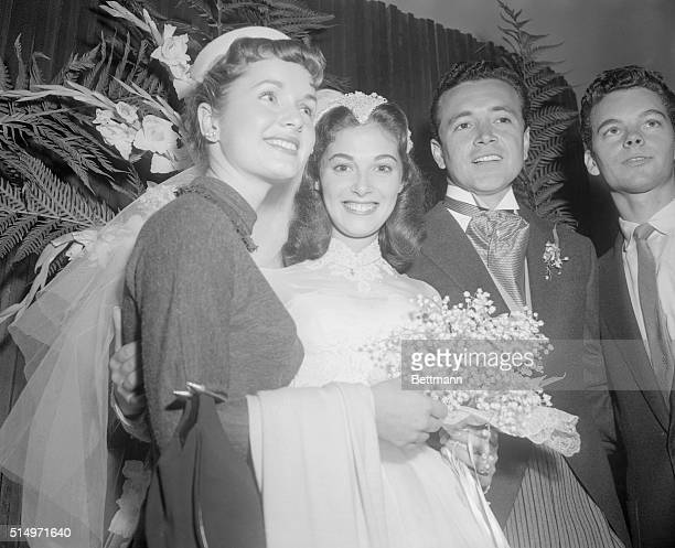 At wedding receptionBridetobe Debbie Reynolds who is engaged to singer Eddie Fisher congratulates bride Pier Angeli and groom Vic Damone at the...