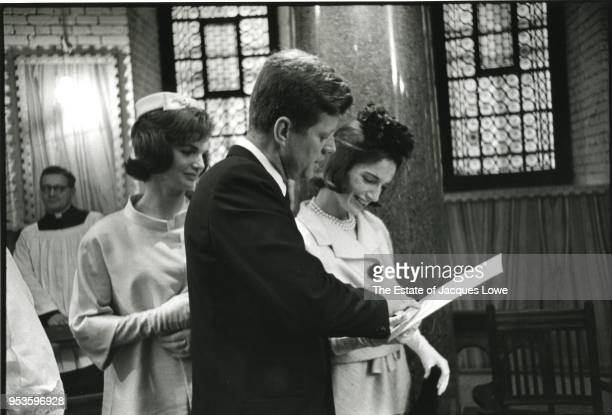 At Westminster Cathedral First Lady Jacqueline Kennedy watches as her husband US President John F Kennedy and sister Princess Lee Radziwill look over...