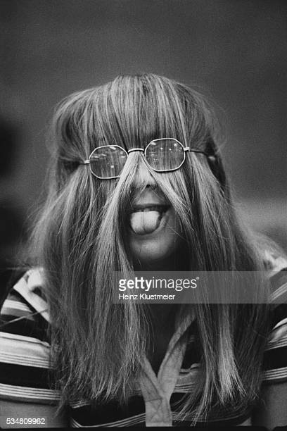 At Wilde Lake High School, a freshman make a face, with her hair inside her glasses and her tongue sticking out, Columbia, Maryland, 1977.