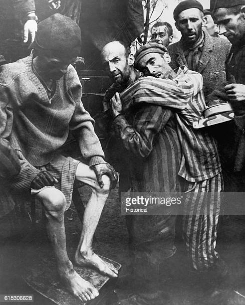 At Wobbelin Concentration Camp recently captured by troops of the 82nd Airborne Division former prisoners are being taken to a hospital for medical...