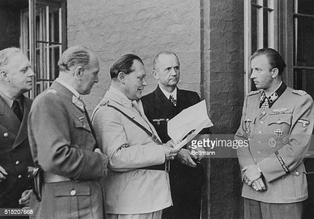 At Wolfsschanze headquarters Hermann Fegelein chief SS adjutant and brotherinlaw of Eva Braun shows his assignment to Joachim von Ribbentrop Bruno...