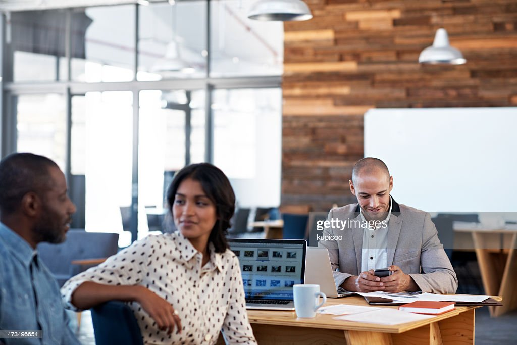 At work in the office : Stock Photo