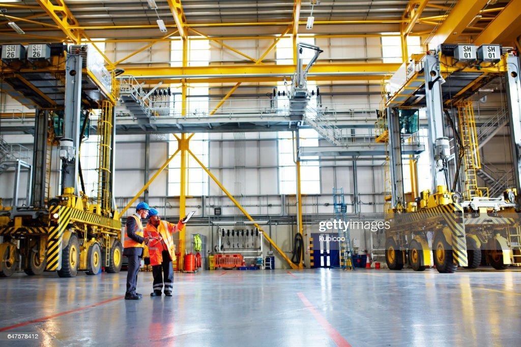 At work on the warehouse floor : Stock Photo