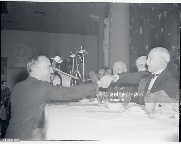 At Wright Anniversary Dinner Washington DCCaptain Eddie Rickenbacker famed World War I flyer shakes hands with Orville Wright across the table at the...
