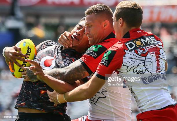 Ata Hingano of the Warriors is tackled by Tariq Sims and Kurt Mann of the Dragons during the 2017 Auckland Nines match between the New Zealand...