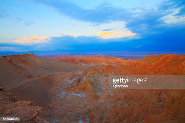 atacama desert, moon and death valley – above dramatic landscape at gold colored sunset panorama –  chile - antofagasta region stock photos and pictures