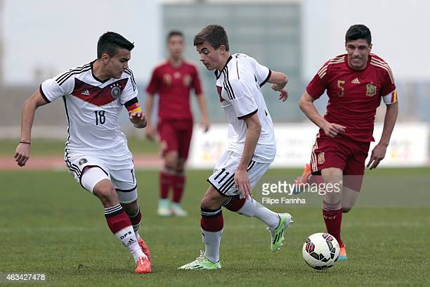 Atakan Akkaynak and Jano Baxmann of Germany challenge Gorka Zabarte of Spain during the U16 UEFA development tournament match between Germany and...