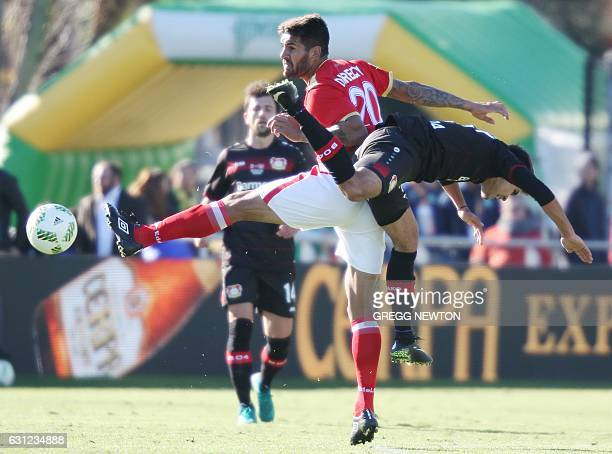 Atakan Akkaynak of Bayer 04 Leverkusen and Javier Toledo of Estudiantes de la Plata of Argentina vie for the ball during the 2017 Florida Cup at Al...