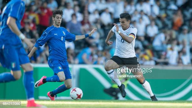 Atakan Akkaynak of Germany is challenged by Filippo Melegoni of Italy during the U18 International Friendly match between Germany and Italy on May 17...