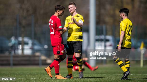 Atakan Akkaynak of Leverkusen and Julian Schwermann of Dortmund shake hands after the A Juniors Bundesliga match between Borussia Dortmund and Bayer...