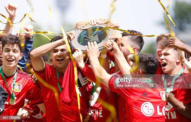 Atakan Akkaynak of Leverkusen and teammates celebrate the win of the cup after the U17 German Championship Final match between Borussia Dortmund U17...
