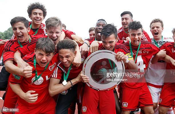 Atakan Akkaynak of Leverkusen and teammates celebrate the win of the trophy during the U17 German Championship Final match between Borussia Dortmund...