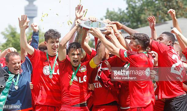 Atakan Akkaynak of Leverkusen and teammates celebrate the win of the trophy during the U17 German Championship Final match between Borussia Dortmund...