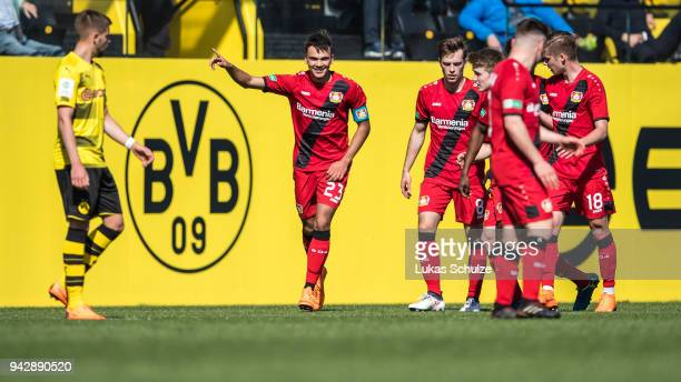 Atakan Akkaynak of Leverkusen celebrates his teams first goal with team mates during the A Juniors Bundesliga match between Borussia Dortmund and...