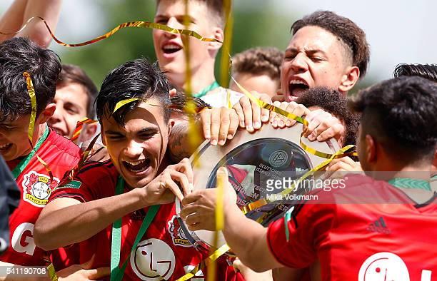 Atakan Akkaynak of Leverkusen celebrates the win of the trophy during the U17 German Championship Final match between Borussia Dortmund U17 and Bayer...