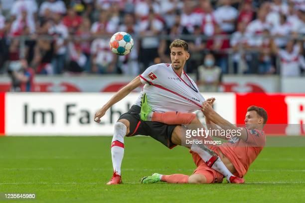 Atakan Karazor of VfB Stuttgart and Dennis Geiger of TSG 1899 Hoffenheim battle for the ball during the Bundesliga match between VfB Stuttgart and...