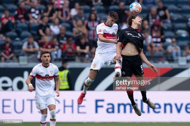 Atakan Karazor of VfB Stuttgart and Sam Lammers of Eintracht Frankfurt battle for the ball during the Bundesliga match between Eintracht Frankfurt...