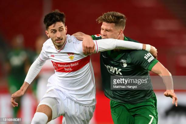 Atakan Karazor of VfB Stuttgart battles for possession with Florian Niederlechner of FC Augsburg during the Bundesliga match between VfB Stuttgart...