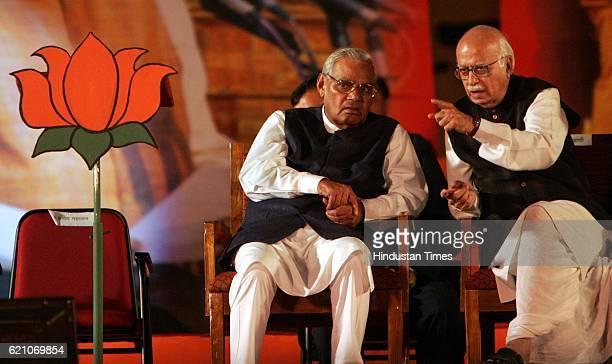 Atal Bihari Vajpayee and LK Advani next to the vacant seat of Pramod Mahajan during the BJP convention held in Mumbai