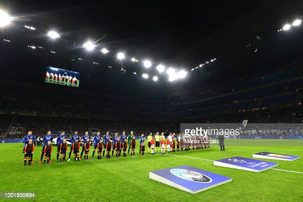 Atalanta and Valencia CF teams line up before the UEFA Champions League round of 16 first leg match between Atalanta and Valencia CF at San Siro...