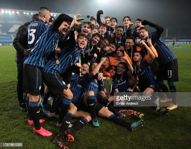 Atalanta BC players celebrate with the trophy the victory of the Primavera Supercup at the end of the Supercoppa Primavera Tim match between Atalanta...