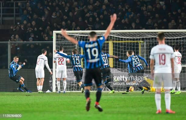 Atalanta players celebrate after Atalanta's Swiss midfielder Remo Freuler open the score during the Italian Serie A football match Atalanta vs AC...