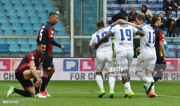 Atalanta Players celebrate after their team scored their 3rd goal as Genoa players look dejected during the Serie A match between Genoa CFC and...