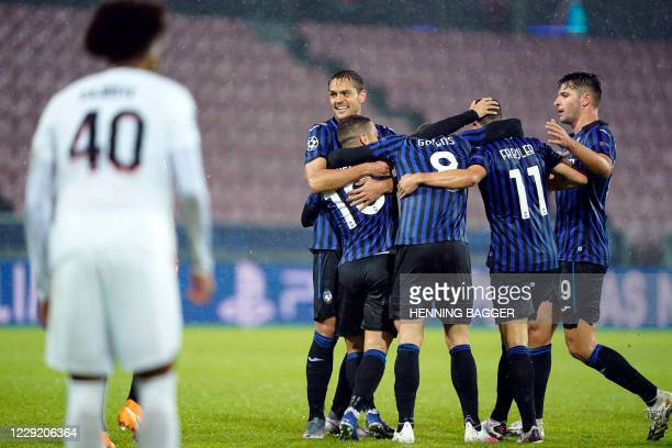 Atalanta players celebrates scoring the 0-2 during the UEFA Champions League group D football match FC Midtjylland v Atalanta in Herning, Denmark on...